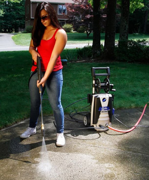 a woman using the AR383SS to clean a sidewalk