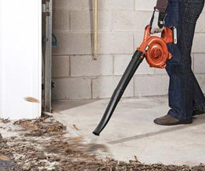 blowing debris out of your garage using the LSW20 sweeper