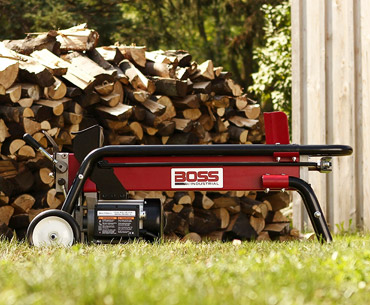 the Boss log splitter and a pile of wood