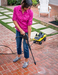 a woman cleaning brick floor