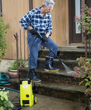 a man using the SPX1000 to clean stairs
