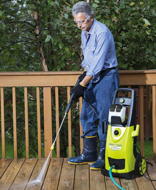 a man cleaning a deck using the SPX3000
