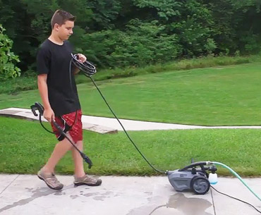 a boy pulling The Force 1800 washer