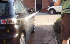 cleaning a car with a Karcher pressure washer